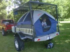 Here is an interesting idea for a compact camping trailer; flat deck trailer with a roof for hauling, then use a truck tent for sleeping quarters