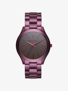 This season our iconic Runway watch gets a polished, plum-hued refresh. Let the stylish stainless steel setting pop opposite gold-tone extras.