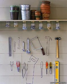 Tool Wall - A hammer and nails are easy to find if everything is kept in its place. Create that place by marking the outlines of tools on a garage wall or above your workbench. First hang your tools, and carefully trace around them lightly in pencil. Then remove the tools, and go over the pencil lines using more visible markers. We used black marker, but paint pens also work well.