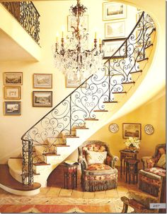 Sensuous staircase and warm inviting colors. Her interiors include a treasure trove of riches a tourist would bring back from a visit to countries bordering the Indian Ocean.  A true Renaissance woman, Von Kersting, has taken her interpretation of the clutter-filled English country home and made it her own.  Her interiors are instantly recognizable - warm, inviting, with splashes of color and pattern, and always a touch of whimsy added for fun. (description by Cote de Texas blogger)