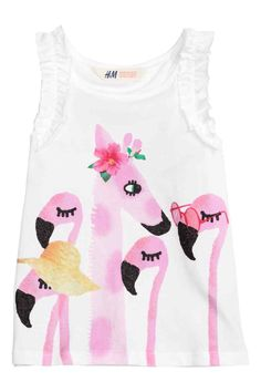 Vest top with a print motif: Vest top in jersey with a print motif on the front and frills on the shoulders.