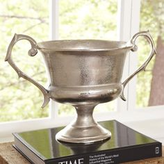 Province Trophy Urn | Give your display an element of distinction with this handsome trophy urn, adorned with elegantly scrolling handles and a textured silver finish.
