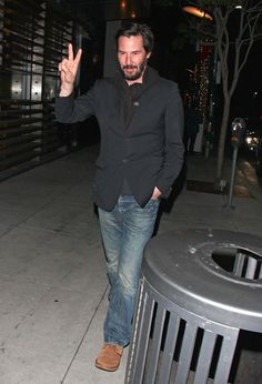 Keanu Reeves seen leaving from the Spago restaurant in Beverly Hills after dining with friends. The 48 year old 'Matrix' star was seen looking a little scruffy wearing his normal beard and was dressed down in blue jeans a black suit jacket.  (December 30, 2012