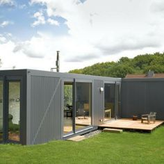 "Modern Shipping Container Homes containerlove"" is a modern shipping container home in a rural area"