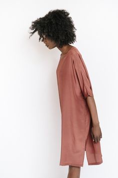The silk dress in marsala from Revisited Matters features a loose fitting silhouette with short sleeves and side slits. Also available in black. Model is 5'9...