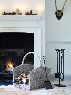 Willow Log Carrier, with white fireplace around it, despite black fire surround. White fluffy rug in front of fire wd be lovely too - not practical tho!