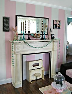 Sweet Taffy 2086-60  @benjamin_moore stripes.  I like the turquoise beaded garland and love tall candlesticks on a mantle.