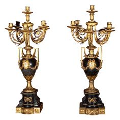 "Magnificent pair of French 19th century Louis XVI style six light candelabra in urn form. CIRCA: 19th Century DIMENSIONS: 31.5"" h x 13.5"" w x 12"" d"