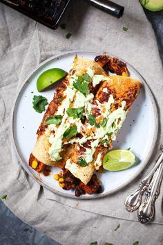 The best vegetarian enchiladas you'll ever eat: Sweet Potato Black Bean Enchiladas packed with flavor and topped with an amazing avocado lime sauce.
