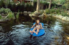 Relax in a Swimming Pond on a raft. designed and built on Long Island by Deck and Patio Company