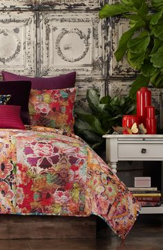 Eclectic prints and a kaleidoscope of vivid colors give this pieced cotton quilt an artful, bohemian look.