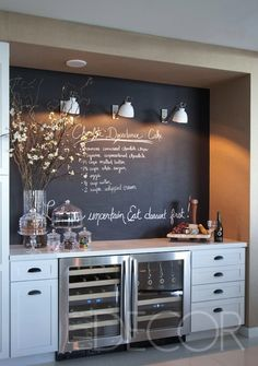 This would also be cute above a kitchen desk/cubbie area! Chalkboard wall in the bar area...love.