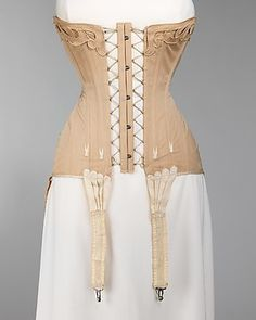 Corset, Bon Marché, 1904-1906, French; cotton, elastic, metal, silk, and bone; the Brooklyn Museum Costume Collection of The Metropolitan Museum of Art.