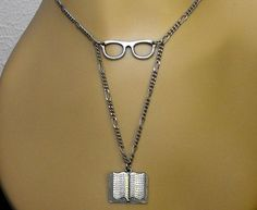 I WANT IT!  (https://www.etsy.com/au/listing/219849231/glasses-book-necklace-reader-bookish?ref=sc_2&plkey=8f55c2b6442670acb645552ab07d81d2dfc239c9%3A219849231&ga_search_query=book+necklace&ga_search_type=all&ga_view_type=gallery)