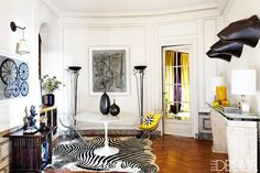 Maximalist living pace with modern furniture and lots of wall decals