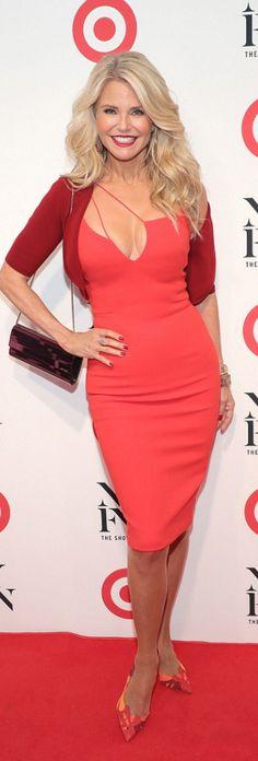 Christie Brinkley in Purse – Jimmy Choo  Dress – Victoria Beckham Collection