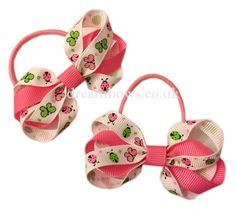 Pink and white butterfly design grosgrain ribbon bows on thin bobbles - www.dreambows.co.uk pinkbows, whitebows, girls bows, girlsbows, hairbows, uk hair bows, baby hair bows, hair design, hair styles, handmade hair accessories, handmade bows, pink and white hair bows