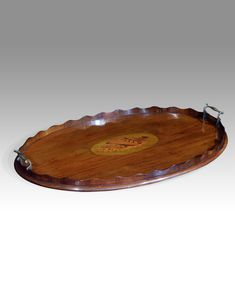 - Edwardian mahogany oval tray. Scalloped gallery with brass carry handles and marquetry shell motif. circa. 1910 £440