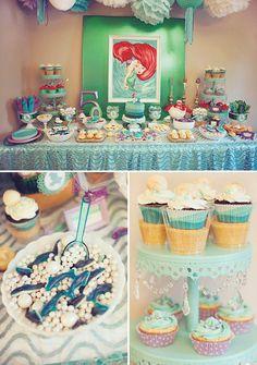A Little Mermaid Birthday Party with Dinglehopper cupcakes, sand dollar cookies, Ariel & Flounder cut out photo booth, Flounder piñata + shark fruit salad