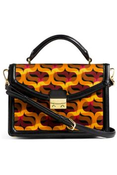 """We have for you the Vera Bradley Lydia Satchel in the Northern Lights pattern.  Does """"feminine and stylish"""" describe you? If so we have your bag! It has all the appeal of a classic handbag silhouette paired with the ease of a shoulder bag.  The detachable black leather shoulder strap matches the rich leather trim on the bag and compliments the modern mix of gold fuchsia brown and black.  It has a rich black satin lining with the new VB monogram.  One back zip pocket will accommodate even the…"""