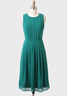 Green pleated dress