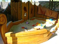 Wow. Carved boat shaped sandbox.