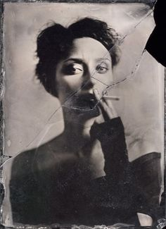Woman with cigarette, broken glass, unknown artist, black and white photo.