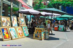 Every Tuesday and Friday the street comes to life with a festival of arts, crafts and performances. Over two-hundred artists set up their stalls on a regular basis and offer unique, handmade wares to pedestrians who wander the three-pronged streets of the neighborhood.