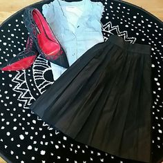 Vegan Faux leather skirt Black faux leather skirt. Sparkle & fade is the designer bought at urban outfitters. It's a size 6 but fits a size 27 waist. Urban Outfitters Skirts Circle & Skater