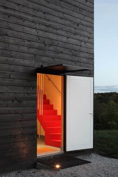 Black-painted timber contrasts with clean white window frames on the walls of this cube-shaped weekend house in Normandy, France. Architecture Cool, Timber Walls, Weekend House, Timber Cladding, Black House, Interior And Exterior, Building A House, Stairs, House Design