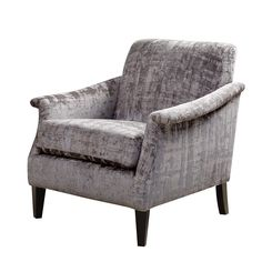 This accent chair offers the comfort of a club chair with a smaller footprint, so it works well in compact spaces. Inspired by mid-century silhouettes, it features elegant bent arms.