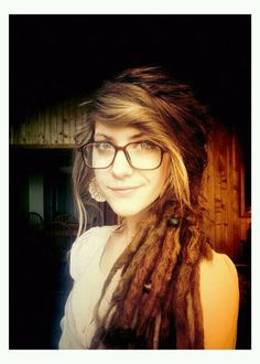 Dreads with bangs out.  I'd definitely leave my bangs out if I were to get dreads...
