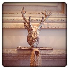 Reindeer stocking hanger.