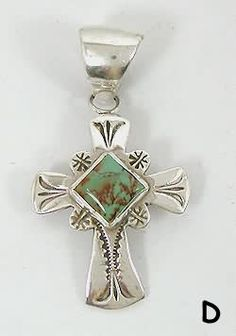Sterling Silver Turquoise Cross pendant created by Navajo silversmith Wilbert Benally