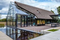 Cottage meets greenhouse in modern thatched home - Curbed