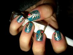 Peacock nails. I keep my nails super short so I can play guitar and also so I don't scratch my kids accidentally, but I would SO rock these if I had the disposable income and the time to sit around and grow nails...