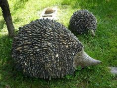 Cute pebbled hedgehogs!  (I think the face & body core are a log that's been tapered on one end.)