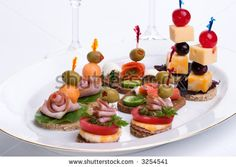 canape sandwiches   Assorted canapes-sandwiches on plate over white background with out of ...