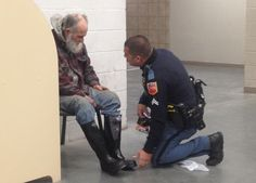 An El Paso Police Officer buys a homeless man new boots, socks, and gloves.