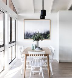 Minimalist dining room with black pendant lights, timber dining table and white chairs. Timber Dining Table, Table And Chairs, Room Chairs, White Dining Table, Office Chairs, Dining Tables, Dining Area, Minimalist Dining Room, Modern Minimalist