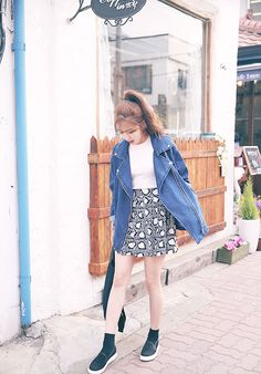 Love the patterned skirt with the large oversized denim blazer.