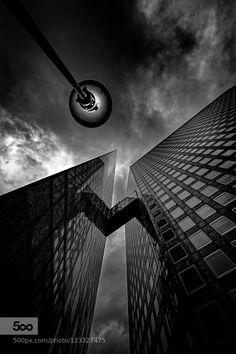 Mad World - Pinned by Mak Khalaf Paris la Défense City and Architecture FranceParisarchitectureblackblackandwhitebuildingcitycityscapecloudsdarkdarknessskysombreurbanurban exploration by Abraham-Kravitz