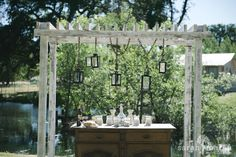 Backyard Wedding in Grass Valley, California - DIY Ceremony backdrop with lanterns  - Sarah Maren Photographers