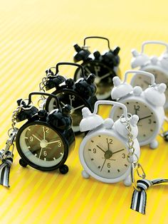"""Key Chain Alarm Clock Wedding Favor . They'll toss these ping-pong-ball-size alarm clocks into their bags every time they travel. """"Mini Bell"""" alarm clocks, $9 each, Kikkerland Design. May Arts ribbon, Paper Presentation, 800-727-3701."""