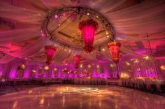 Draping, wall wash lighting and custom interior lit fabric hanging centerpieces!
