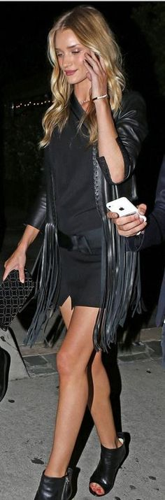 Rosie Huntington-Whiteley: Jacket – Kate Moss for Topshop  Shoes – Gianvito Rossi  Dress – Isabel Marant  Purse – Alaia  Jewelry – Anita Ko