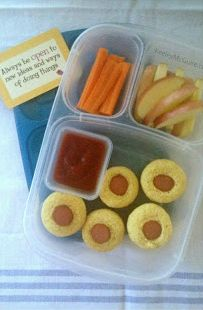 Mini Corn Dog Lunch features  gluten free mini corn dog muffins (freezer friendly and a great way to use up leftover hot dogs), apple slices, carrots and ketchup for dipping. Visit the site for the 15 minute recipe.