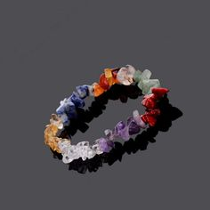 7 Chakra Reiki Prayer Bracelet Made From Natural Healing Crystals. Jewelry by Peace of Mindfulness. Chakras are used for balancing energy, cleansing and restoring energy through meditation practice. Plus, they look ultra stylish and make great fashion accessories for any outfit.