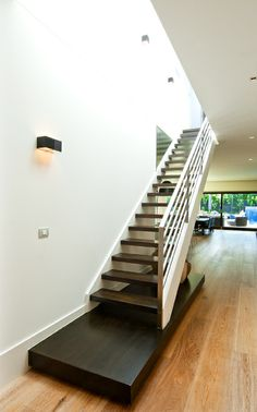 Stainless Steel Balustrade | Handrail | American Oak | Dark Stain | White Closed Stringers | Open Stair | Feature Landing | Contrast | Staircase