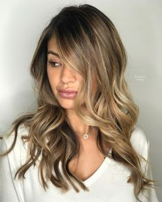 We're living for this classic lived-in caramel brunette balayage by Aveda Artist Karen Marenco.